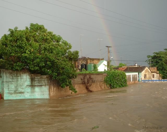 arcoiris-y-rio-inundado